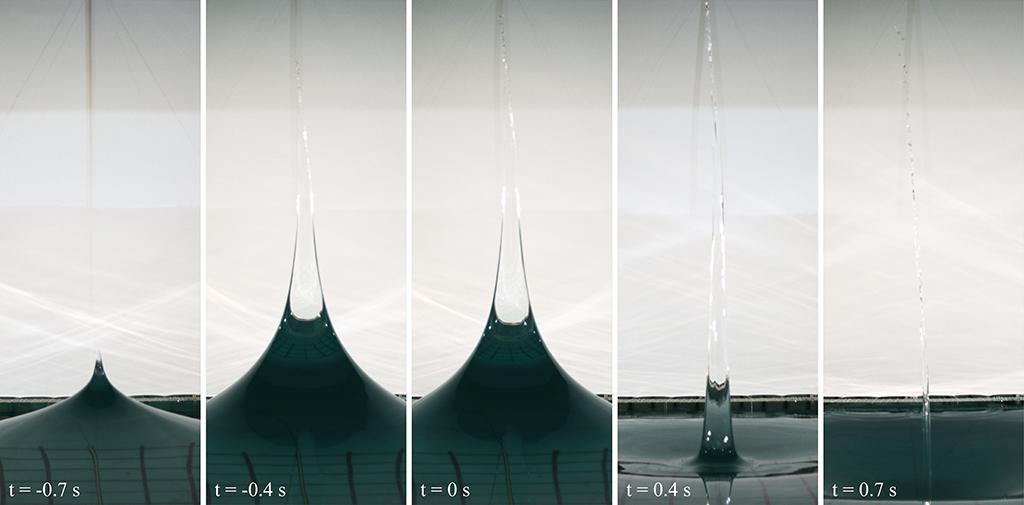 Video of Jet formation on an axisymmetric standing wave created in the FloWave circular wave tank at the University of Edinburgh. A jet emanates from the crest of the wave, which is produced by the collapse of the preceding trough, the jet then undergoes free fall where Plateau-Rayleigh instability is observed. The video has been slowed down from a frame rate of 125 fps to 30 fps.